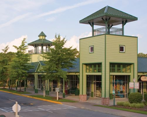 The green buildings of Tanger Outlets in Bluffton, South Carolina.